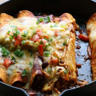 Chicken and Black Bean Enchiladas! Small batch enchiladas made with flour tortillas, roast chicken, black beans and enchilada sauce, so good!