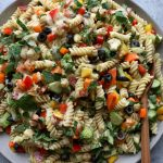 Summer Pasta Salad with a Dijon vinaigrette. So easy to make and delicious! Super versatile, use any short or small pasta, mix with the raw veggies of your choice and mix in the dressing and enjoy!