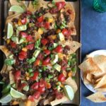 Loaded Sheet Pan Nachos! Packed with ground beef, and lot of cheese and vegetables, this one is a family favorite for sure! So easy to make!