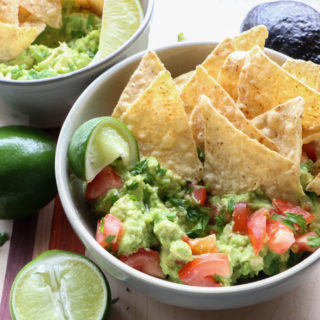 Best Chunky Guacamole! Super simple and so easy to make! Ripe avocados, fresh lime juice and salt with finely diced red onions, tomatoes and cilantro.