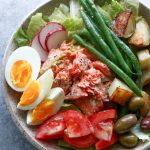Salmon Nicoise Salad with roasted salmon, potatoes, haricots verts, tomatoes, eggs and olives, topped with a delicious vinaigrette!