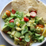 Delicious Avocado and Tomato Salad! Super easy to make and so flavorful! We'll definitely be eating this all summer long.