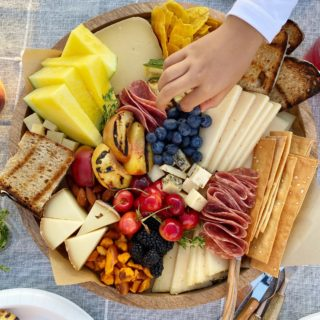 Summer Themed Cheese Board with Grilled Fruit! Celebrate summer with all of your favorite things! We love grilling bread, veggies and fruit!