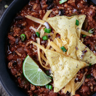 Instant Pot Beef Chili. Filled with ground beef, onions and three types of beans, this chili is sure to be a winner for dinner!