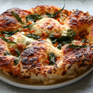 Roasted Honeynut Squash and Kale Pizza made with Food 52's pizza crust. So incredibly delicious! You have to try it!