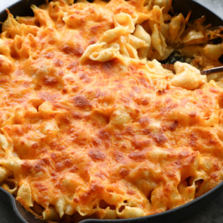 Creamy Baked Macaroni and Cheese! Starting with a milk-and-egg base, smoked paprika and more, and loaded delicious cheeses, this is the best!