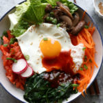 Salmon Bibimbap! Everything you love about Korean Bibimbap but with cooked salmon! Mix it all together, it's so good!