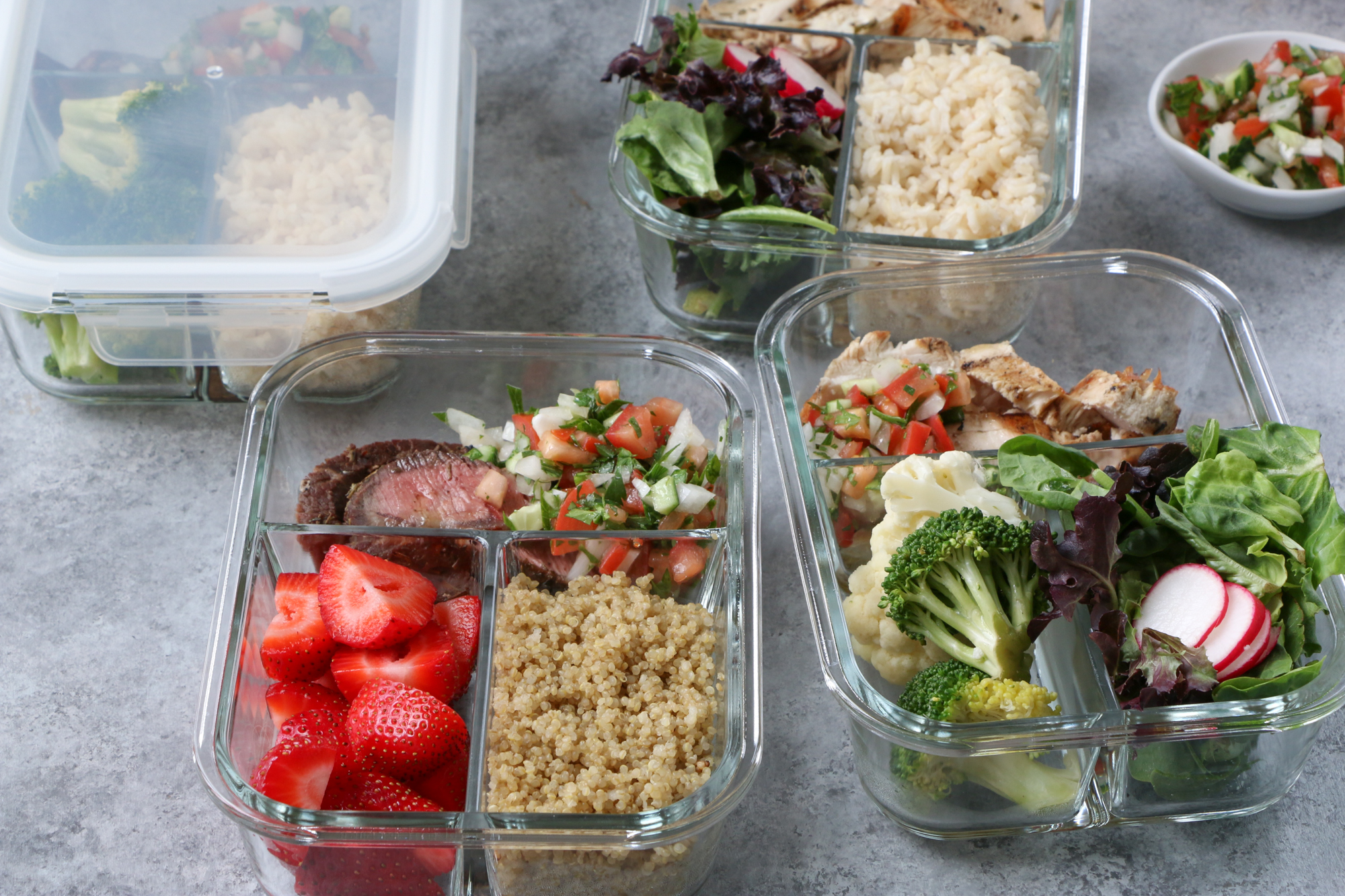 Make Ahead Meals with ALDI: Marinated Flat Iron Steak and chicken with brown rice, quinoa and steamed vegetables.