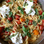 Spaghetti with Ricotta and Tomatoes! Creamy, flavorful and so delicious! This one comes together in under 30 minutes and is absolutely delicious. The ricotta makes the pasta creamier and the pesto takes the entire dish up a notch in my opinion. Mix everything together and it's heaven. Hope you try it!