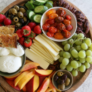 Burrata Cheese Board with nectarines and roasted tomatoes. Make something easy and special to snack on. Enjoy with friends and family.