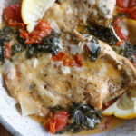 Creamy Tuscan Chicken! Succulent and flavorful chicken bathed in a creamy, cheesy rich sauce. Enjoy this alone, or with pasta, bread or roasted potatoes.