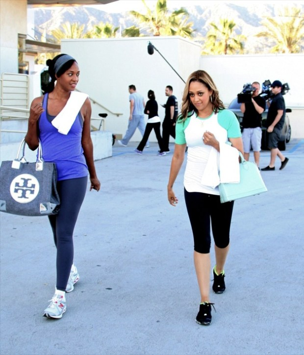 """**EXCLUSIVE** Tia Mowry is all smiles as she leaves Crunch Gym with her cousin Keisha while filming her reality show """"Tia & Tamera"""" in LA"""