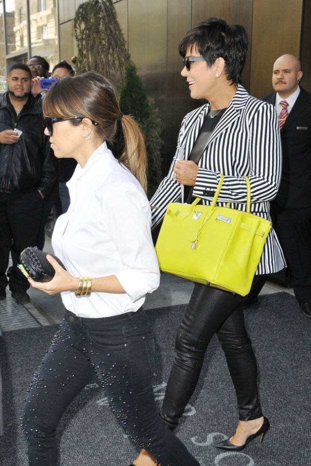 A pregnant Kim Kardashian is seen leaving Trump SoHo with Kris Jenner and Kourtney Kardashian in New York City
