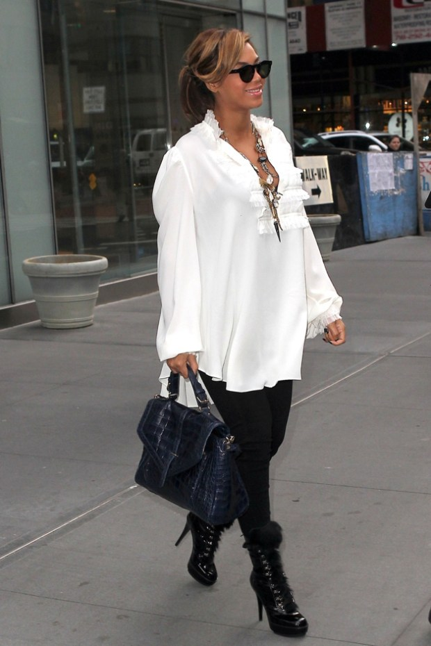 Beyonce Knowles keeps her baby bump under wraps as she leaves an office building in Manhattan