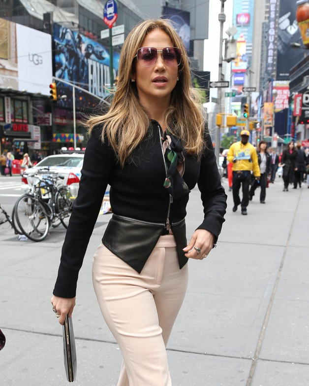 Jennifer Lopez, wearing a tight black jacket and light pink dress pants, heads out around Midtown in New York City