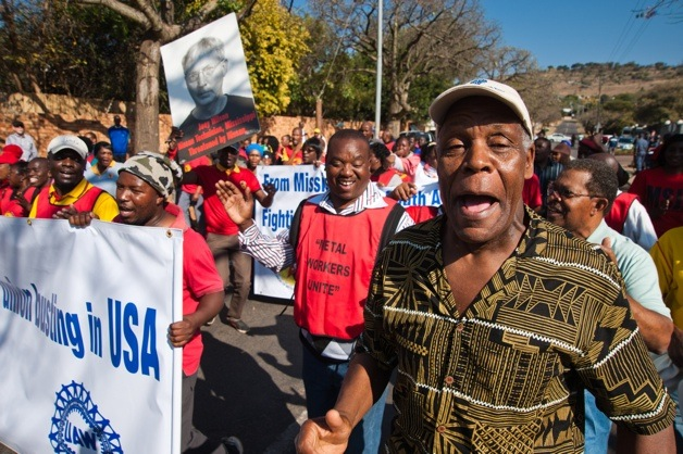 Danny Glover along with National Union of Metalworkers of South Africa (NUMSA) members hold a picket outside the Japanese Embassy in Pretoria
