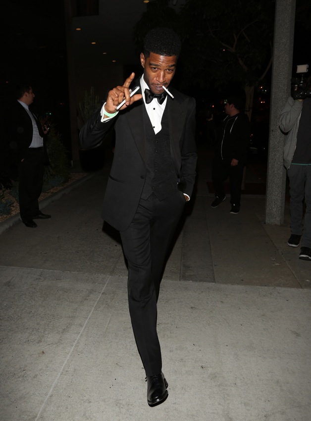 Kid Cudi smokes a cigarette as he leaves Bootsy Bellows after attending the GQ event in West Hollywood