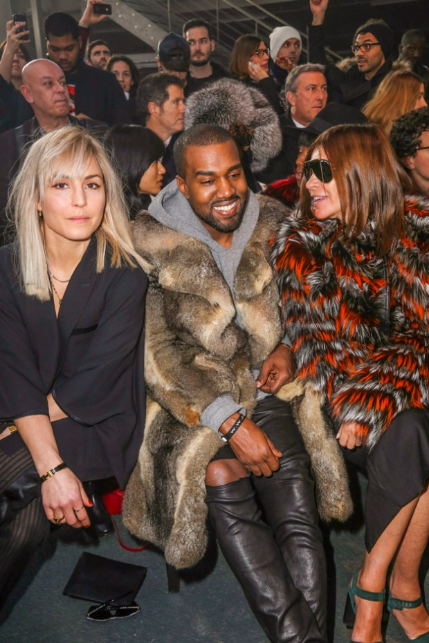 "Noomi Rapace and Kanye West seen at the ""Givenchy"" fashion show during the Paris Fashion Week in Paris"