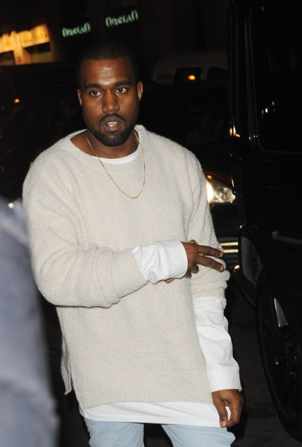 Kanye West heads into his Parisian home after reportedly inviting Rihanna and Drake to his party