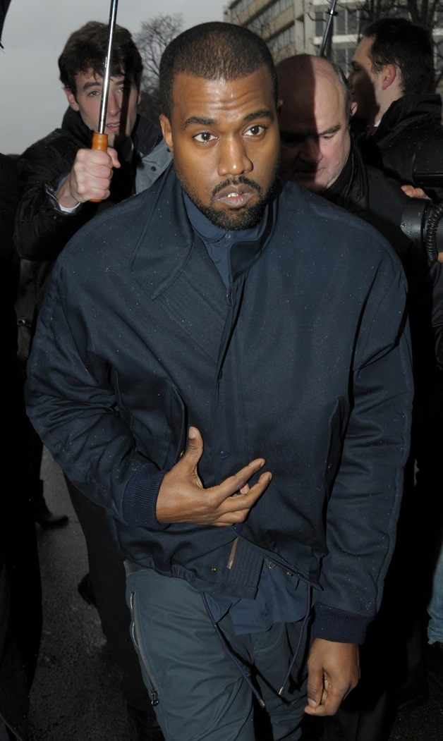 Kanye West attend the Balenciaga show as part of the Paris Fashion Week Womenswear Fall/Winter 2014-2015 in Paris