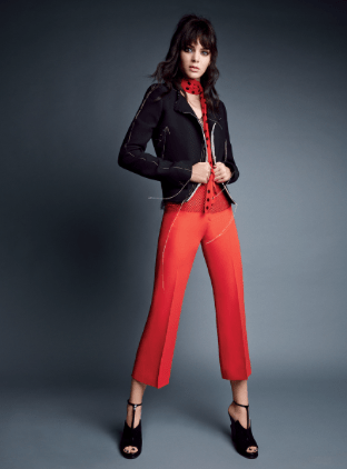 Lanvin short jacket ($3,695) and mesh top ($580); select Saks Fifth Avenue stores. Versace silk-cady wide-leg pants, $995; select Versace boutiques. Saint Laurent by Hedi Slimane polka-dot scarf. Jimmy Choo T-strap sandals.