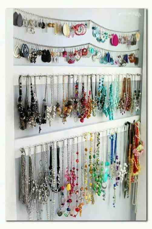 Jewelry hanging on walls with hooks