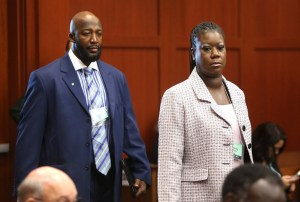 Trayvon's mother and father (Tracy Martin and Sabrina Fulton) arrives at court