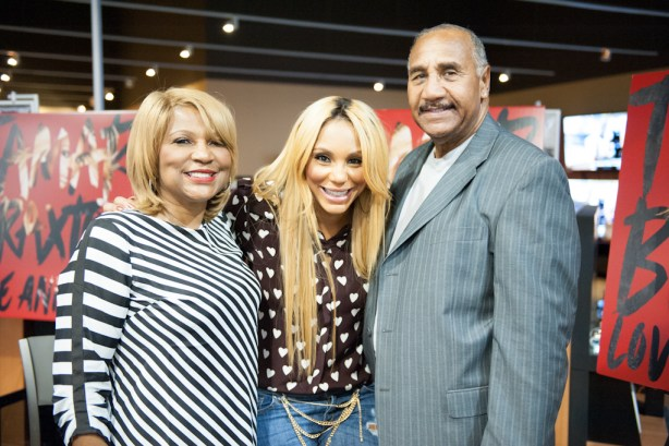 Tamar with parents Evelyn and Michael Braxton