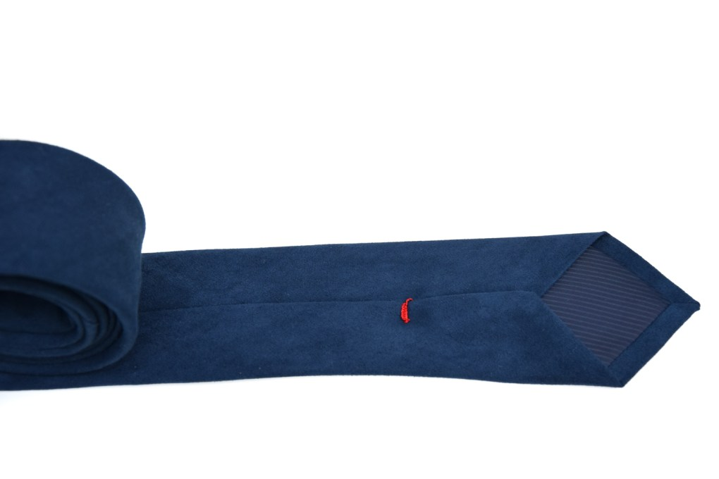 Blauwe suède stropdas.