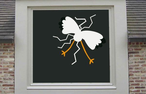 raamsticker ooievaar tegen raam