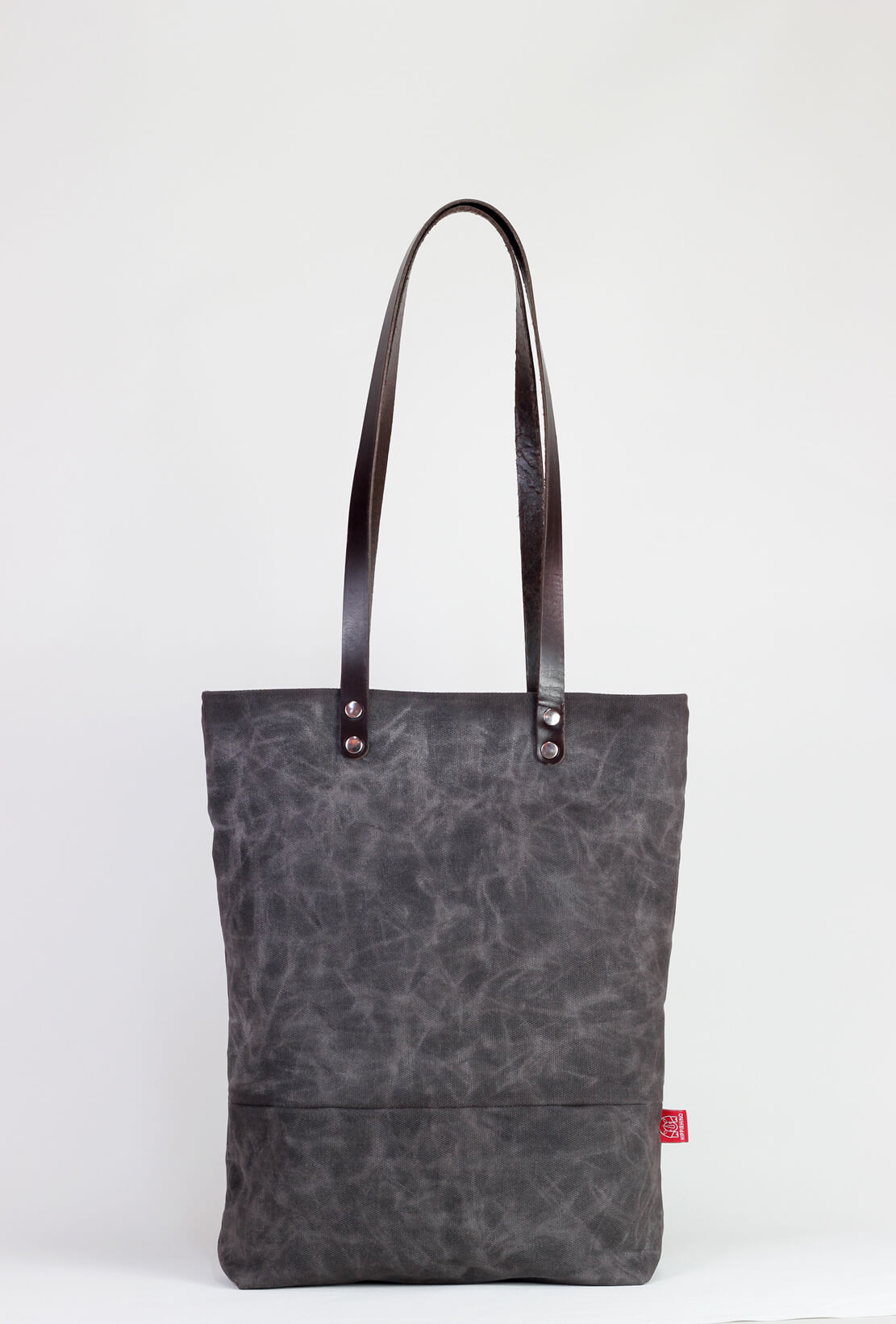 Natural canvas tote with dark brown leather straps