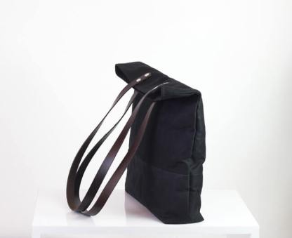 Black waxed tote bag with leather strap