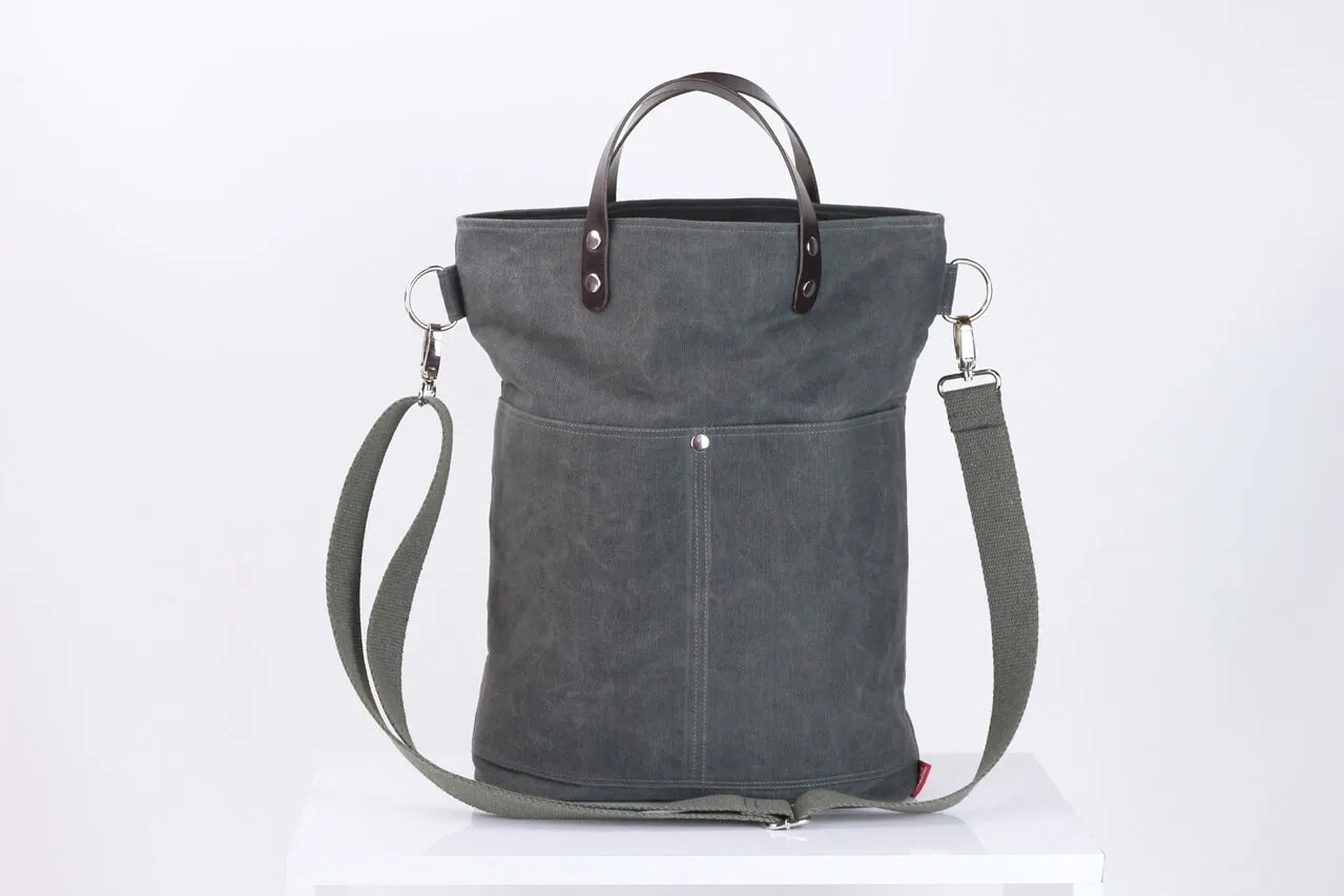 waxed canvas bag with leather handles and closures,soft grey color