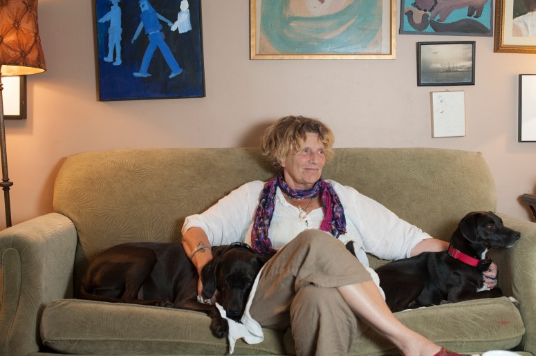 abigail thomas with two dogs on couch