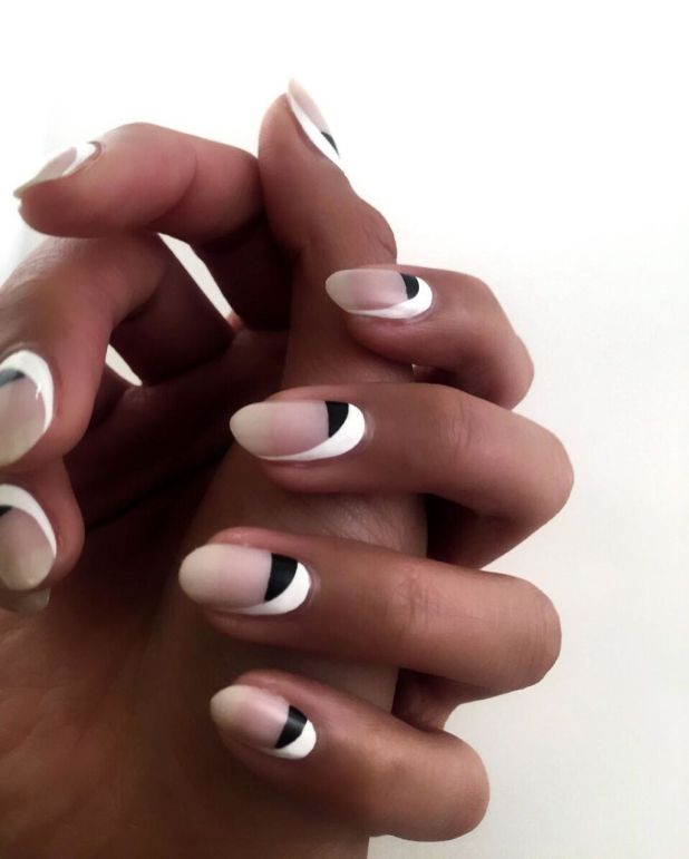 """<p><span class=""""redactor-invisible-space"""" data-verified=""""redactor"""" data-redactor-tag=""""span"""" data-redactor-class=""""redactor-invisible-space"""">Here's another one for negative nail-enthusiasts. Try this monochrome look by painting your half moons black, then add aswooping splash of white to one side of the nail.</span></p><p><em data-redactor-tag=""""em"""" data-verified=""""redactor"""">Design by</em><a href=""""https://www.instagram.com/p/BDlaONurUjD/"""" target=""""_blank""""><em data-redactor-tag=""""em"""" data-verified=""""redactor"""">@ladyfancynails</em></a></p>"""