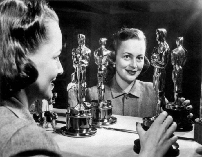 olivia de havilland with her first two oscars