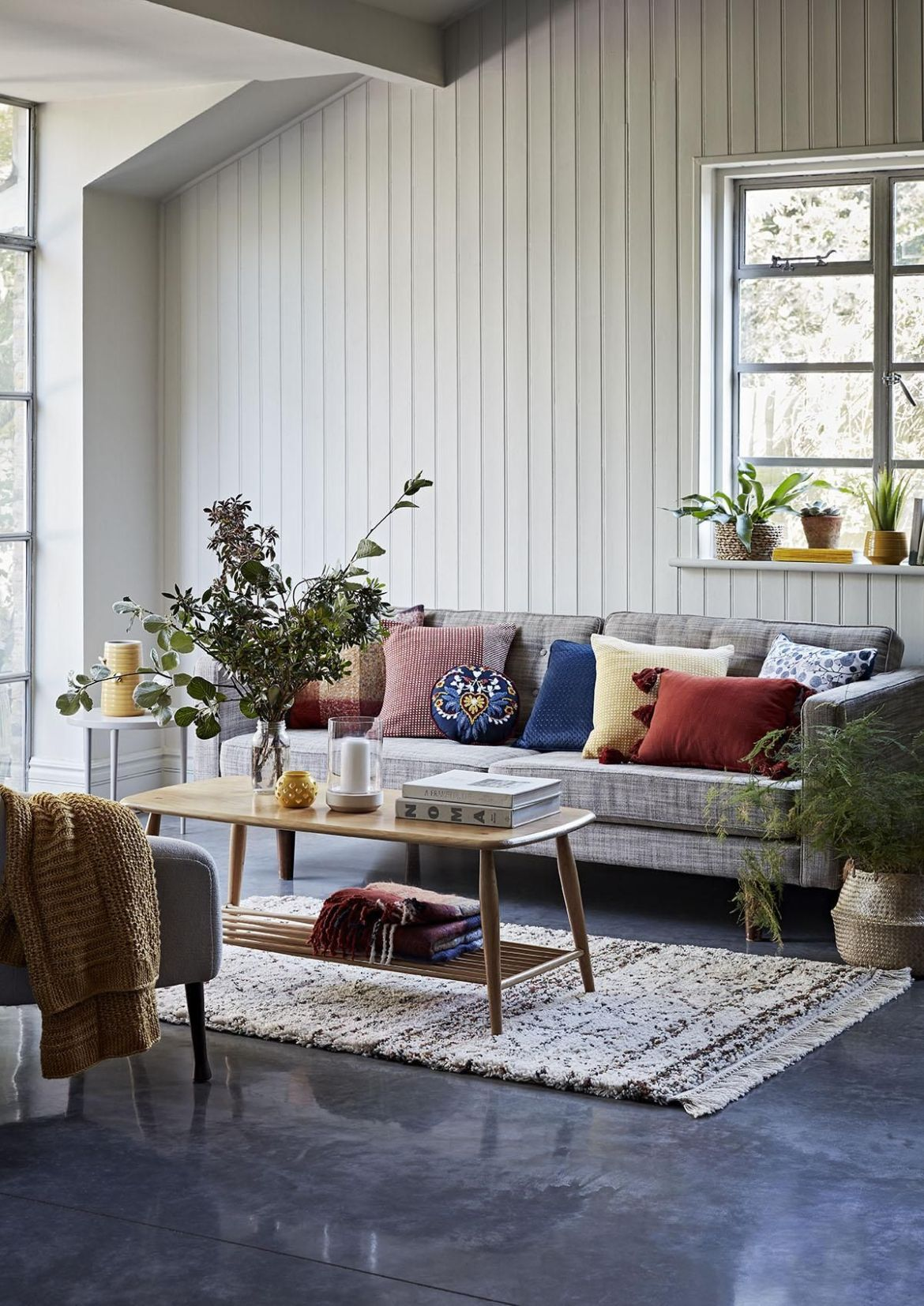 cosy living room with rugs, throws and cushions
