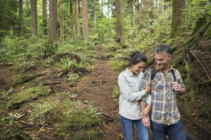 Couple hiking on trail in woods