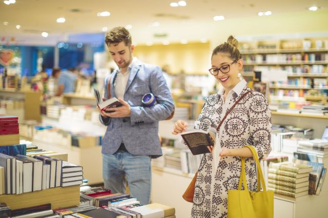 Couple is selecting new books in the bookstore