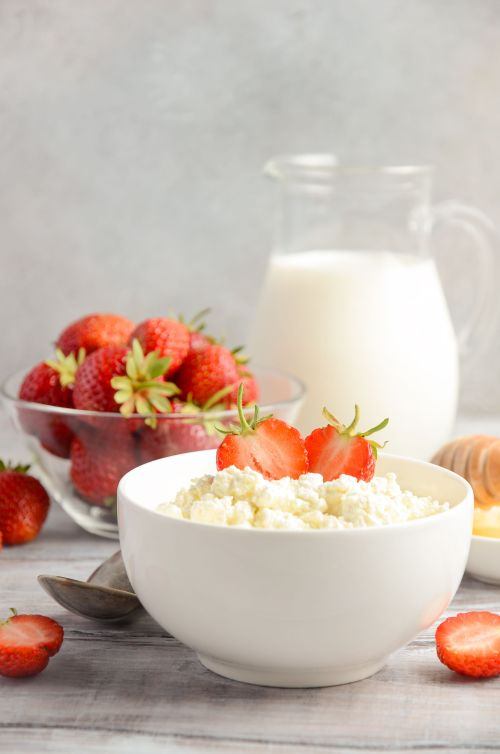 Fresh cottage cheese with fresh strawberries, healthy breakfast concept
