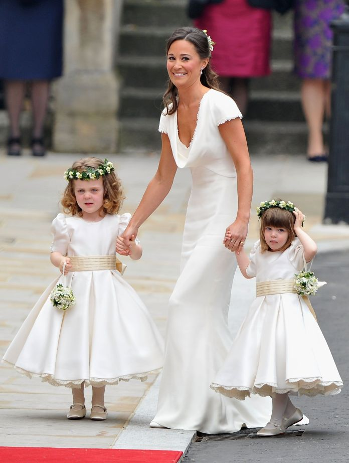 London, England April 29th sister of the bride and bridesmaid Pippa Middleton holds the hands of Grace Van Cutem and Eliza Lopes as they arrive to attend the royal wedding of Prince William with Catherine Middleton at Westminster Abbey on the 29th April 2011 in London, England the wedding of the second in line with the British throne will be led by the Archbishop of Canterbury and will bring together 1,900 guests, including members of the foreign royal family and heads of state, thousands of supporters around the world whole also flocked to london to attend the spectacle and the pageantry of the royal wedding photo by pascal le segretaingetty images