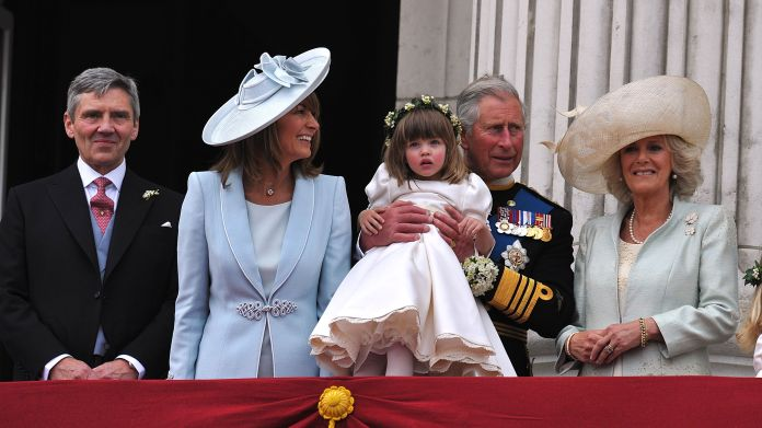 London, england, april 29 lr michael middleton, carole middleton, prince charles, prince of wales holding the bridesmaid eliza lopes and camilla, duchess of cornwall on the balcony of buckingham palace after the royal wedding of prince william to catherine middleton April 29, 2011 in London, England, the wedding of the second in line with the British throne was led by the Archbishop of Canterbury and brought together 1,900 guests, including members of the foreign royal family and heads of state , thousands of supporters around the world also gathered for London to attend the royal wedding spectacle and pageantry photo by John Stillwell WPA Poolgetty Images