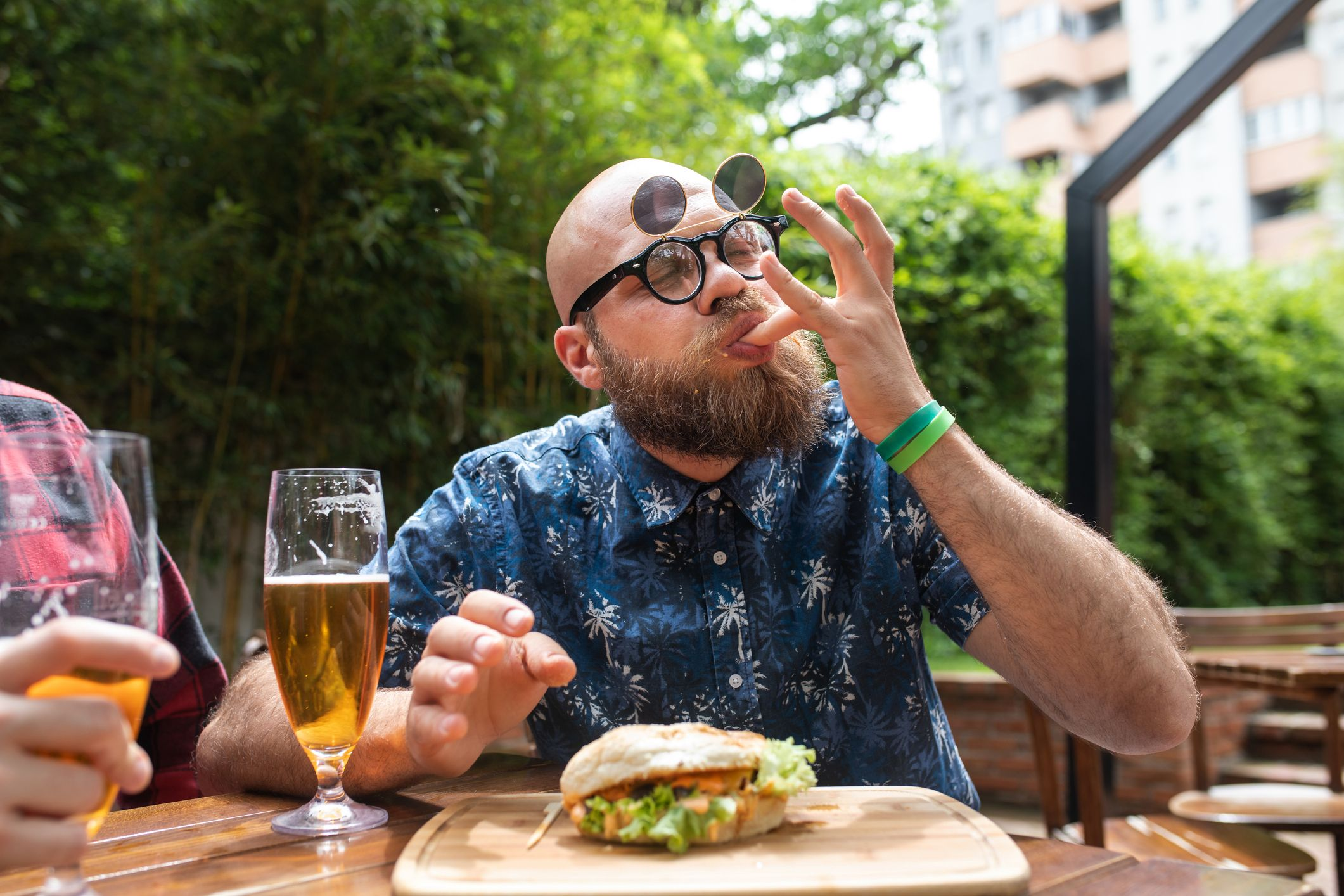 man enjoying a meal with his friend