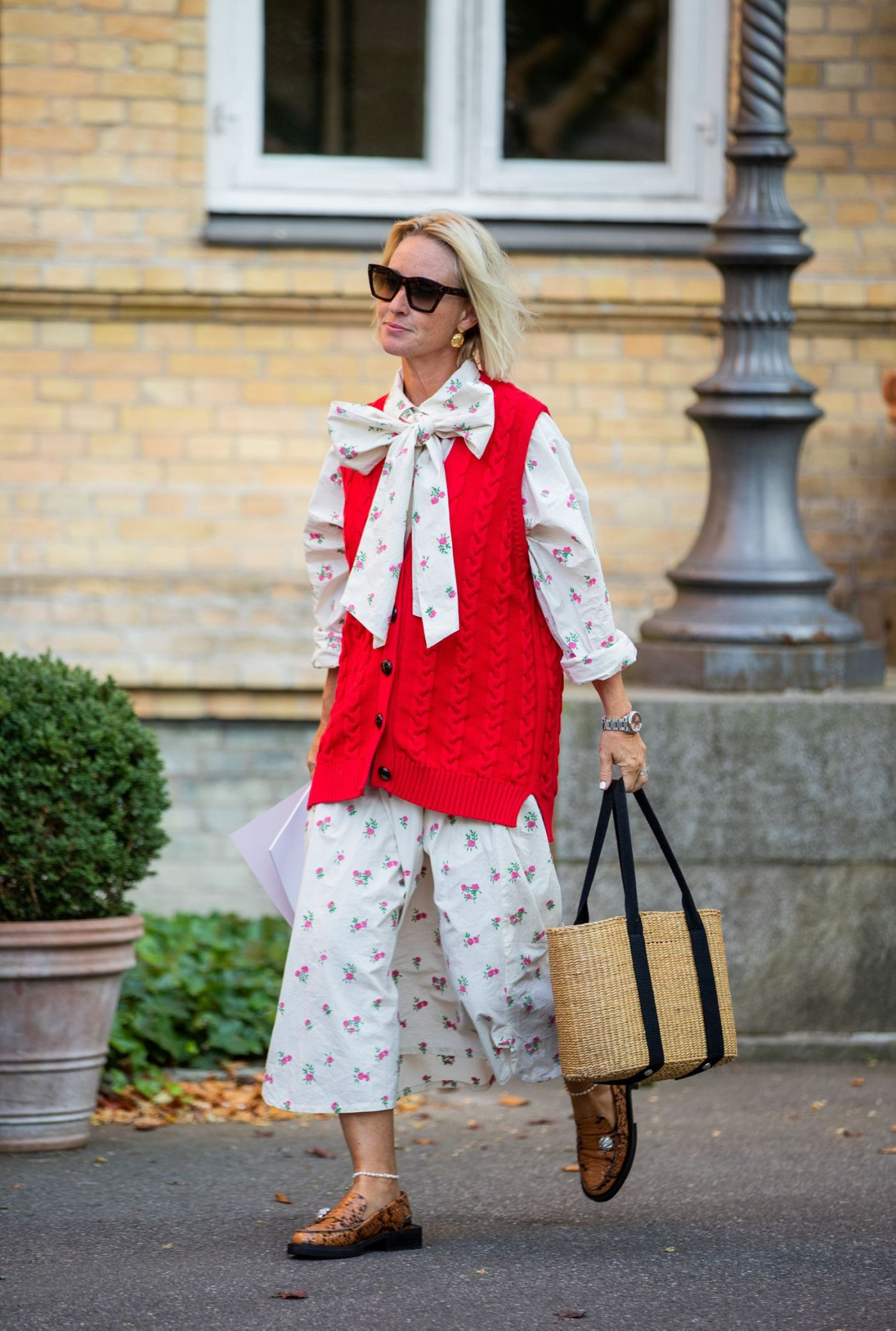 copenhagen, denmark august 12 a guest is seen wearing red vest, dress with floral print outside by malene birger during copenhagen fashion week springsummer 2021 on august 12, 2020 in copenhagen, denmark photo by christian vieriggetty images