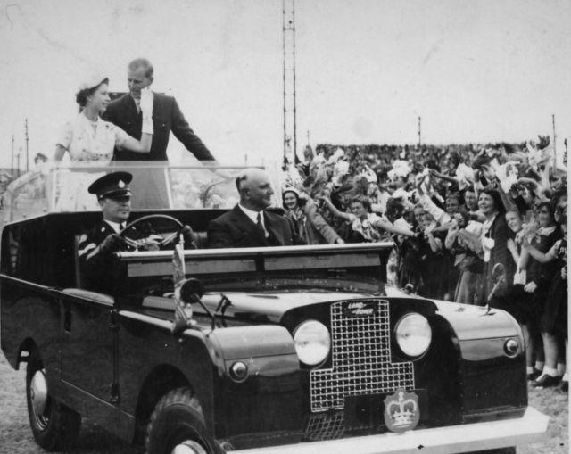 queen elizabeth ii and the duke of edinburgh in an open top land rover