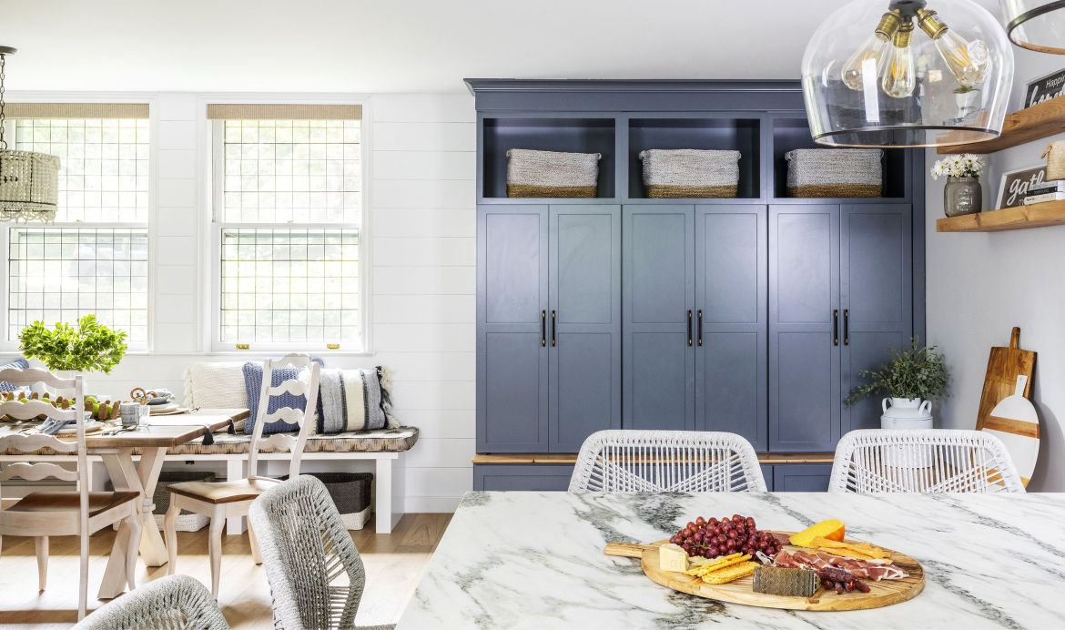 home featuring warm neutrals and soothing blue hues to accent the beautiful architecture of the vintage home interior designer karen b wolf mudroom in kitchen corner