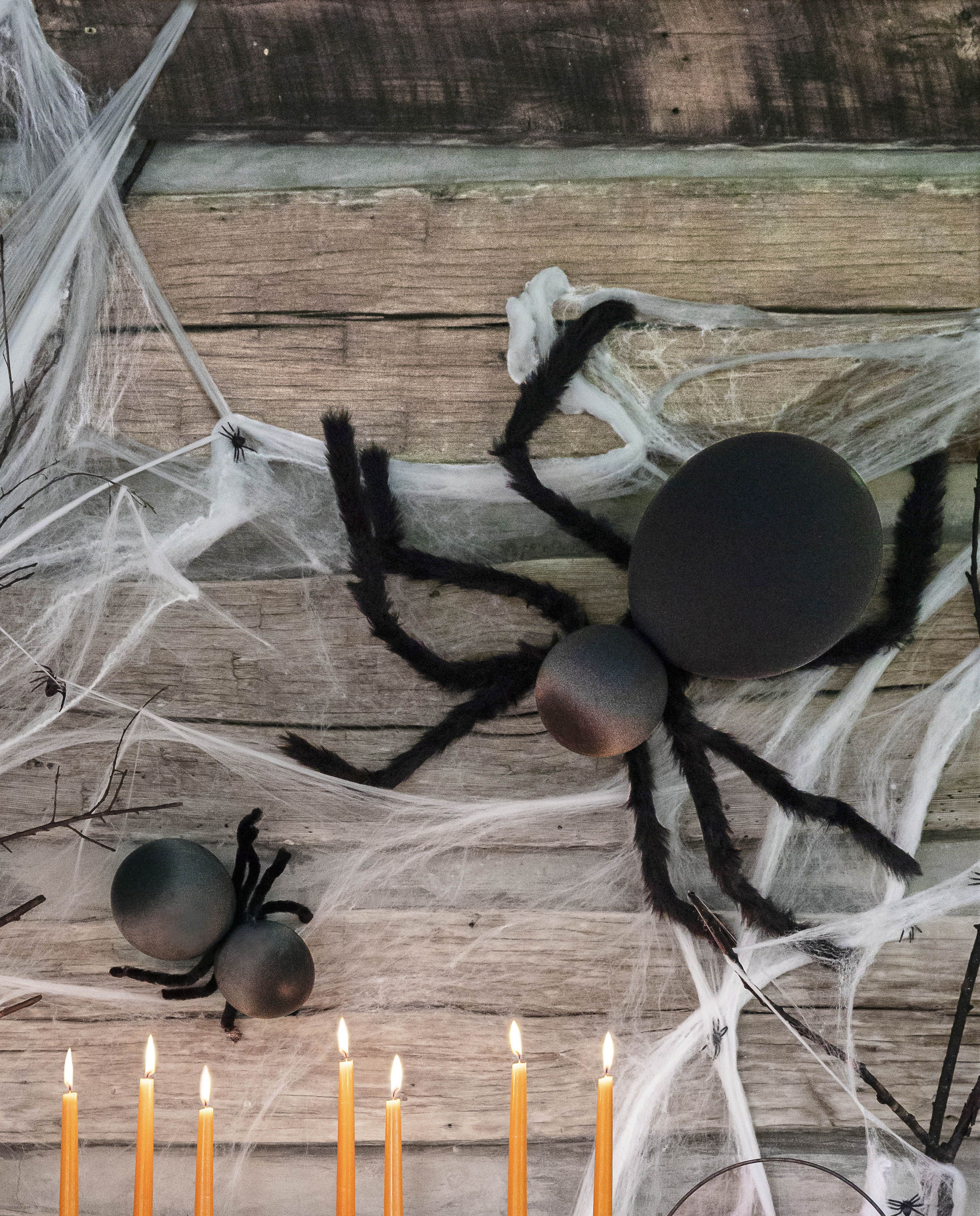 giant spiders on a wall made from ballons and wire