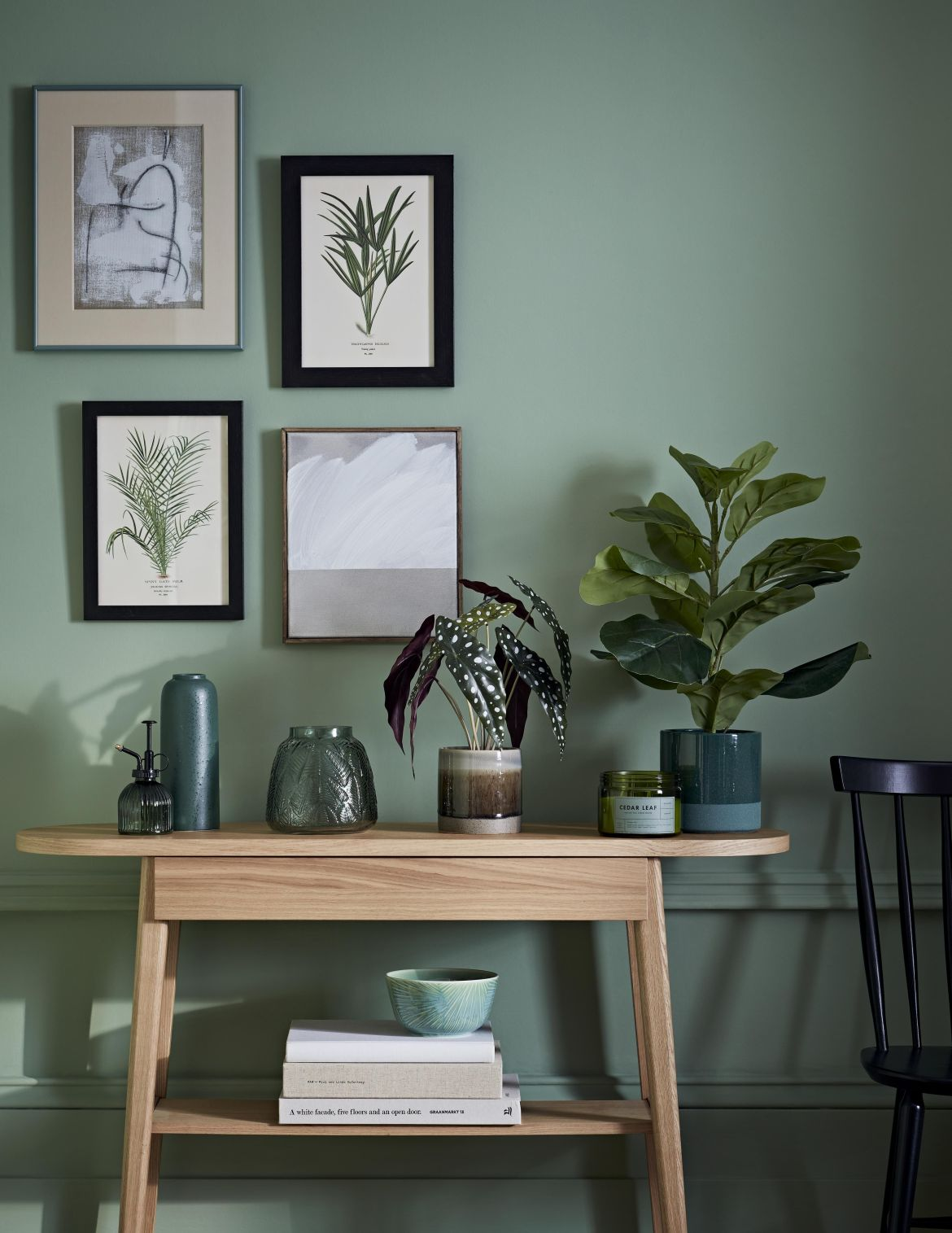 stylish room with green paint and wooden sideboard