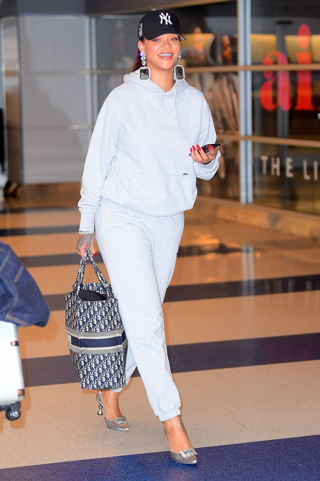 EXCLUSIVE: Rihanna Pairs Manolo Blahnik Heels With A Grey Sweatsuit As She Jets Into NYC For Her Pop Up Shop Opening