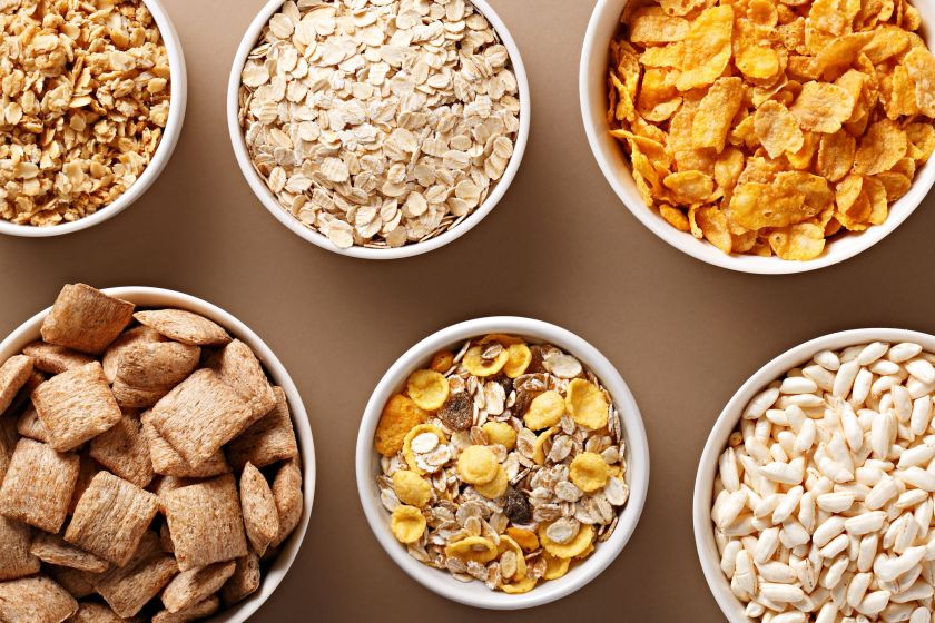 High Angle View Of Breakfast Cereals Served In Bowls On Table